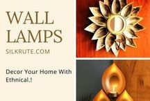 Wall Lamps / A #lamp that is fixed onto a wall. #WallLamps are a smart alternative to traditional nightstand lamps. Silkrute offers you an exclusive collection of #WallMountedLamps, #HandmadeLamps, #WallLampsforBedroom etc. #Decor your #Home more stylish with these #WallSconces.