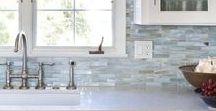 Westchester Coastal Kitchen / Blue glass backsplash, brass finishes, white kitchen cabinets, marble counter top
