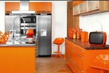 Orange Kitchens / Adventurous designs of cabinets, curtains and tablecloths with an orange kitchen in mind.