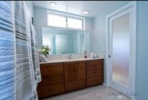Bathroom Design 13 / A contemporary style bathroom with blue frosted glass shower.