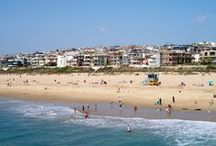 See Manhattan Beach / Manhattan Beach in California is a city located in the Los Angeles, South Bay region. It is one of South Bay's three beach cities, and is popular for its surfing and beach volleyball events.