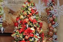 Christmas Tree-Christmas Sparkle Theme / Christmas Sparkle- Traditional Red and Green sparkle with accents of silver and touches of gold. Pop this tradition with a playful mix of black and white patterns, checks, chevron and polka dots. Rich red poinsettias with red roses and lime green glitter sprays adds a fresh touch. Lime green adds a punch of color to celebrate Christmas with a new twist on tradition.