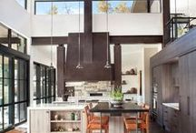 Mountain Retreat / A dramatic steel hood takes the lead, surrounded by contemporary elegance and natural materials to create a mountain retreat.