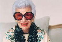 I*R*I*S / Iris Apfel is admired for her radical ideas of fashion and her 'hallmark' of exotic colorful baubles.  Called the RARE BIRD OF FASHION, and even at the age of 94, she is like the Energizer Bunny.  She just keeps on going,   Her husband Carl and she shared a business in the textile industry based in New York City.   The enchanting fashions she designs are adorned in elegance and much sought after.