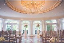 Queens Landing Weddings / Set on the banks of the Niagara River, Queen's Landing is a stately mansion featuring Venetian windows, heavy pediments with moldings, and large columns. The interior is adorned with marble flooring, sweeping spiral staircase and brilliant stained glass ceilings - all grand details that serve as a wonderful backdrop to your wedding photography.