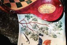 ✜ The Retired Saddle ✜ / The retired saddle has become my canvas and is given new life as art. The result is a beautiful piece to complement the discerning collector of equestrian-inspired art or decor. By Lisa Curry Mair of Canvasworks Designs.
