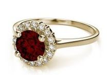 January Garent Birthstone / Garnet, the birthstone for January, signifies eternal friendship and trust.  Garnet comes in a rainbow of colors, from deep red to a vibrant green. Most commonly adorned is the red wine colored Pyrope Garnet.