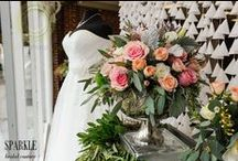 Anything But Simple At SPARKLE... / Thank you so much to the very talented Ramona Arnold and the team of Simple Country Weddings and Vintage Decor for creating such a romantic, beautiful scene for our January 2016 display. (http://simplecountryweddings.com/) Also, a very special thanks to Accents by Sage Floral Design, Go West Baking and Events, and Tuxedo Den for helping make this display as gorgeous as it is and Shoop's Photography for capturing all the details so perfectly. (http://www.shoopstudios.com/)