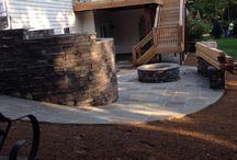 BACK YARD / Patio, cedar deck, stone, rock wall, propane firepit, outdoor living / by Carmel Feldman