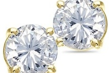 50% OFF ALL DIAMOND SOLITAIRE EARRINGS! / by Andrews Jewelers