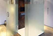Bespoke shower doors and screens / Bespoke shower screens finished by Creative Glass Studio based in London. Hinged shower doors, frameless shower enclosures and sliding shower screens.
