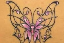 Tattoos / by Maria Woodson