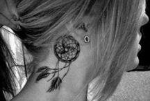 Tattoos & Piercings / by Jessey F