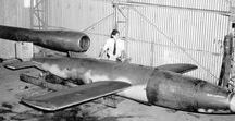 """Missiles: V-1 (Fiesler Fi 103) / The V-1 missile or V-1 flying bomb (German: Vergeltungswaffe 1 """"Vengeance Weapon 1""""- also known to the Allies as the buzz bomb, or doodlebug, and in Germany as Kirschkern (cherrystone) or Maikäfer (maybug) - was an early cruise missile and the first production aircraft to use a pulsejet for power. The V-1 was developed at Peenemünde Army Research Center by the German Luftwaffe during the Second World War."""