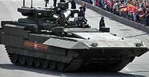 """Military: T-15 Armata (Russian: T-15 Армата) / The T-15 Armata (Russian: T-15 Армата), with industrial designation """"Object 149"""", is a Russian heavy infantry fighting vehicle first seen in public (initially with its turret covered) in 2015 during rehearsals for the Moscow Victory Day Parade. The T-15 is expected to replace the BMP-2 and MT-LB. The T-15 is based on the T-14 tank hull, with its engine relocated to the front to accommodate a passenger compartment in the rear, which adds the engine as a type of shield against frontal hits."""