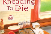 Kneading to Die / Agatha nominee and the first book in the Pawsitively Organic Mystery Series