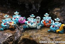 Polymer Clay Robots Simply Charming Minis / FuzzyKims©, BubbleBellyBots© and all other Designs are COPYRIGHTED by Kimmie's Clay Kreations®, 2017. All images, rights, colors, designs, concept, and intellectual property belong solely to the owner of Kimmie's Clay Kreations.