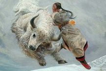 Wang Yiguang / Wang Yiguang (Chinese: 王沂光; Pinyin: Wáng Yíguāng) is a modern Chinese painter notable for his Tibetan paintings of flying people, yaks and sheep.