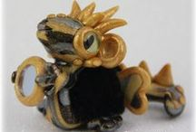 FuzzyKim Dragons / Cute Collectible Whimsical Polymer Clay FuzzyKims that come in a handmade gift box along with an adoption certificate. These are available on my website. Visit my website at: http://www.kimmiesclaykreations.com  FuzzyKims©, are COPYRIGHTED by Kimmie's Clay Kreations®, 2016. All images, rights, colors, designs, concept, and intellectual property belong solely to the owner of Kimmie's Clay Kreations.