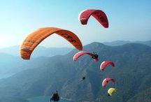 Paragliding / Paragliding is the recreational and competitive adventure sport of flying paragliders: lightweight, free-flying, foot-launched glider aircraft with no rigid primary structure. The pilot sits in a harness suspended below a fabric wing comprising a large number of interconnected baffled cells.