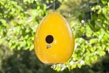 "Egg Bird Houses / Give birds a place to hatch their young with the colorful and durable handcrafted stoneware Egg Bird House. The 1 1/8"" diameter entry hole will attract chickadees, wrens, and smaller birds, keeping house sparrows out. Available in seven glossy colors. / by J Schatz"