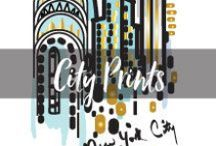 City Prints / Celebrate the spirit of your favorite cities in this playful collection of hand painted prints from artist Elizabeth Lamb. These limited edition designs for the iPhone 6/6s and iPhone 6 Plus/6s Plus have been thoughtfully illustrated to capture the iconic and whimsical scenes and cityscapes throughout New York, Miami, Chicago, Los Angeles and San Francisco. With beautiful metallic accents and vivid colors, the City Prints collection lets you visit your favorite city each and every day.