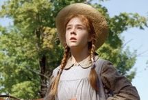 """Anne of Green Gables / The joy of sincere work and worthy aspiration and congenial friendship were to be hers; nothing could rob her of her birthright of fancy or her ideal world of dreams. And there was always the bend in the road!  """"'God's in his heaven, all's right with the world,'"""" whispered Anne softly.― L.M. Montgomery, Anne of Green Gables"""