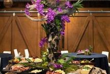 Buffet Floral Arrangements / For buffet florals, I recommend going big or go home. This is one of the places that every guest will see. Pick a big showstopper arrangement and raise it above the food so that it can be seen all evening. Make it something that guests will talk about. Often the ceremony flowers can do double duty here. Ask your florist or planner to move the arrangements after the ceremony during the cocktail hour.