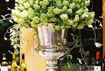 Bar Floral Arrangements / The bar is one place every almost every adult wedding guest will visit. Here is a good place to splurge a little on a showstopping arrangement