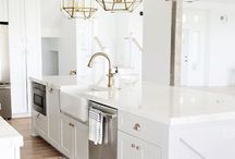 Kitchen / Clean, modern, bright, open kitchen ideas. White cabinets and countertops with a touch of glamorous hardware.