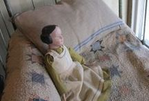 Olde Primitive Dolls / I think primitive dolls should have a spot on the porch, in the hall and overflow from old wood trunks and boxes.  A prim doll looks great in an old high chair and a quilt shelf would be naked without one... / by Gwenandchuck Milledge