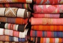 Bolivian blanket heaven / I love them! I am a HUGE blanket fan. Blankets represent shelter, warmth, safety, comfort and security...a beautiful thing to collect. Much as I love Navajo blankets, and Moroccan wedding blankets, these incredible pieces take the prize IMHO. There is just something so elegant, simple yet timeless in the beautiful arrangement of stripes and color combinations...subtle ombre shades with brights and neutrals that seems to work every time. Here are some of my favorites to feast your design buds on!