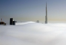 Dubai: Cloud City, Fog & Mist / The city in the clouds: Dramatic images of Dubai's skyscrapers poking through a carpet of fog at night. Dubai's skyscrapers poke through a carpet of fog at night in dramatic images taken from 800ft up in the air. The world's tallest building - the 2,700ft-high Burj Khalifa - can be seen bursting through the dense fog banks which descend on the city in March year year. Photography by Ian Powell / Barcroft Media. / by I Love Dubai