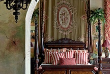 Style Colonial British French Spanish Tropical Travel Hemingway Travel Style / Inspiration for my guest bedroom.  One wall has old vintage wallpaper of tropical sandy grassy knolls and the sea. I want the room to feel like one has traveled to a tropical destination with old world charm, dark wood furniture, old fashioned luggage, etc.