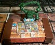 HeroQuest / HeroQuest fue un juego de mazmorras en formato de tablero diseñado por Stephen Baker (de la empresa estadounidense Milton Bradley) y comercializado por Milton Bradley y Games Workshop a partir de 1989.1 Fue reeditado en 1990 y 1991 pero en el curso de los años 90 dejó de ser distribuido. En 1991 obtuvo el Premio Origins a la mejor presentación gráfica de un juego de guerra.