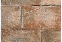Cucina della Nonna - Italian Farmhouse Terra Cotta Tile Wall & Floor Collection / Finally...finally we bring you a hand made reclaimed reproduction Italian terra cotta tile that captures reclaimed terra cotta tiles in all it's patina, texture and color.  Each tile is hand-molded and kiln fired following the age old tradition of tile making.  However, this clay is further worked by skilled Italian craftsmen to achieve a terra cotta tile that is simply magnifico.