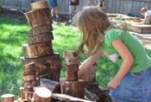 Play: Building (Big) / Fort-building, child-scaled structure building, large-scale/outdoor blocks.
