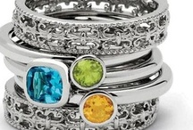 Stackable Birthstone Rings / Stack your kids birthstones! Beautiful, rich, faceted gemstones set in .925 sterling silver. Each ring style is available in a variety of gemstones. Our stackable rings were designed specifically to fit together nicely and offer a variety of combinations. Accent spacer rings in varying widths and textures add enhanced design flexibility for stacking. http://www.mommybracelets.com/rings/stackable-rings