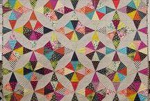 circular quilt blocks / traditional quilt blocks like wedding ring blocks, flowering snowball blocks, drunkard's path blocks, kaleidoscope blocks, Dresden plate blocks interpreted in a modern way using modern colours