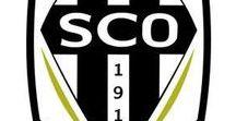• football • SCO Angers / Angers SCO, club de football professionnel, a été fondé en 1919, la même année de création de la F.F.F. Créé sous l'impulsion des frères Fortin, directeurs de la banque du Crédit de l'Ouest, le club a pris le nom de Sporting Club du Crédit de l'Ouest pour rapidement devenir Sporting Club de l'Ouest. A Baugé en Anjou, naturellement, on  supporte le SCO, au féminin comme au masculin