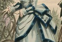 1870, Late Victorian (1870-1890), trains / Later Victorian (1870-1890). Belle Epoque (1870–1914),  In 1870, ball gowns featured trains;  In the 1870s, women drew up the side hair but let it hang in long, loose curls in back. Crimping became popular in the early 1870s.