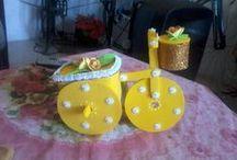 Bicicleta con Cd y tarro de mantequilla