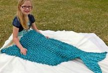 "Crochet: Mermaid Blanket DIY / So far, most are saying up to 10 skeins of yarn are used. It just depends on which stitch you use.  Some are tube shaped & some are flat with a foot pocket at the bottom of the tail.  Use a ""fish scale"" looking stitch."