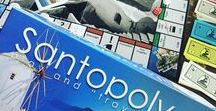 Santopoly | Santorini Board Game / Buy! Sell! Build! Force your opponents to bankruptcy! Share lots of fun moments with the best real-estate board game that will travel you to this unique greek island!