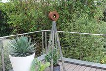 Metallic / Steel, aluminum, zinc, chrome. Metallic finishes inspire us and look sleek in our modern garden.