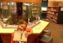 "aadlshelfies / Summer Game players were challenged to take a ""shelfie"" in the stacks! / by Ann Arbor District Library"