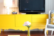 Family Entertainment / Your entertainment room doesn't have to be the standard big screen TV with deep couches. Liven it up with pops of color and inspired textures