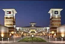 Grand Prairie Premium Outlets / This new shopping destination features more than 100 stores with savings of 25% to 65%. Stores include Bloomingdale's Outlet, DKNY, Joe's Jeans, Michael Kors, Saks Fifth Avenue OFF 5TH, Tommy Bahama, Under Armour, Coach and more.