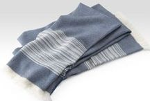 "Wraps / Wool Throw/Wrap in our ""Saturn Stripe"" design. Made of super-fine wool from Italy. Crafted in Maine. We love the silky smooth hand and lightweight warmth! The tight twill pattern features a wide border of jaunty stripes. Generously sized with fringe at each end. Sides have raw edges. Dry clean only. / by Brahms Mount"