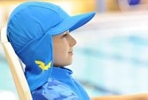Banz Flap (Legionnaire) Sunhats / Designed to be worn in and around the water, Banz Flap Hats are made from the same top-quality Lycra/nylon fabric as our swimwear. Three sizes, 3-18mths, 18mths-4 yrs, 4-8yrs. * Ultraviolet Protective Factor of 50+ cuts out 98% of burning UV rays! * Generous legionnaire flap at back and wide peak at front really protect faces and necks * Band of cotton terry towelling-like fabric sewn under the peak soaks up sweat * These hats dry in a flash! Available from www.babybanz.co.nz (NZ residents only)